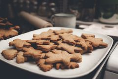Gingerbread man cookies on the white plate. Stock Image
