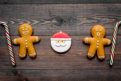Gingerbread man cookies for New Year meal on wooden background top view Stock Images