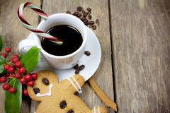 Gingerbread man and a cup of coffee Royalty Free Stock Image