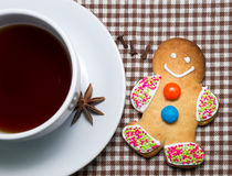 Gingerbread man with cup of hot tea Royalty Free Stock Images
