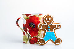 Gingerbread man and cup of tea on white background Stock Photos