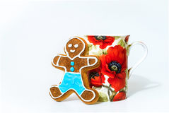 Gingerbread man and cup of tea on white background Stock Image
