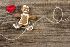 Gingerbread man and cute red hearts. On wooden background. Copy space Royalty Free Stock Photography