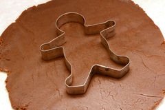 Gingerbread man cutter on cookie dough Royalty Free Stock Photo