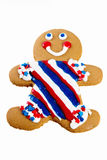 Gingerbread man. Decked out in his red white and blue striped icing suit. Patriotic red white and blue theme Royalty Free Stock Photography