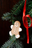 Gingerbread man decorated with Christmas tree and red ribbon Royalty Free Stock Images