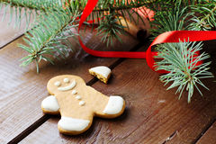 Gingerbread man decorated with Christmas tree and red ribbon Royalty Free Stock Image