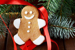 Gingerbread man decorated with Christmas tree and red ribbon Stock Photography