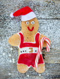 Gingerbread man decorated colored icing. Holiday cookie in shape Stock Image