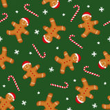 Gingerbread man is decorated in Xmas hat and candy cane on green background. Seamless vector pattern for new year's day, Christmas, winter holiday, cooking Stock Image