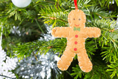 Gingerbread man decoration on a christmas tree Royalty Free Stock Photos