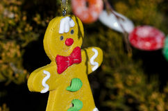 Gingerbread Man Decoration on an Outdoor Christmas Tree Royalty Free Stock Images