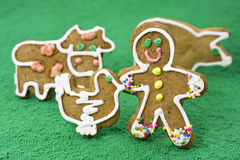 Gingerbread man in a farm. With gingerbread animals and fake turf stock images