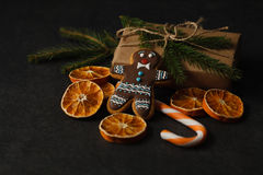 Gingerbread man festive Christmas cookie on wooden table, holida Royalty Free Stock Photo