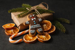 Gingerbread man festive Christmas cookie on wooden table, holida Stock Photo