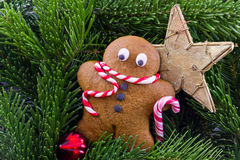 Gingerbread man with fir trees and a star Royalty Free Stock Photography