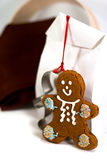 Gingerbread man and gift bag Stock Photography