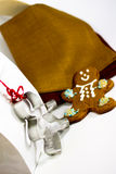 Gingerbread man and gift bag Royalty Free Stock Photos