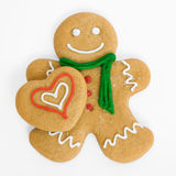Gingerbread man with gingerbread heart Stock Photography