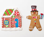 Gingerbread man and gingerbread house Stock Images