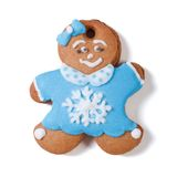 Gingerbread man. Girl with bow in blue coat with snowflake Stock Photos