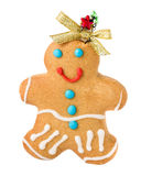 Gingerbread Man Girl Christmas Cookie with golden bow isolated o Stock Photo