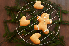 Gingerbread man and heart on grille Stock Photography