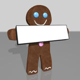 Gingerbread man holding sign Royalty Free Stock Images
