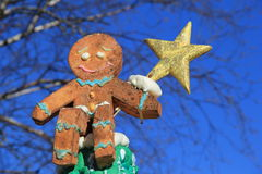 Gingerbread Man Holding Star Stock Image