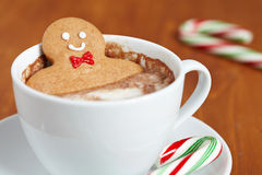 Gingerbread man in hot chocolate Stock Image