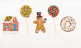 Gingerbread man, house and lollipops Stock Photography