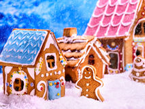Gingerbread man and house near Christmas tree cookie . Royalty Free Stock Images