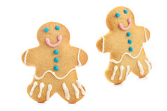 Gingerbread man isolated over white background. Holiday Christmas cookie decorated with colorful icing. royalty free stock photography
