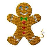 Gingerbread man of knitted fabric  on white background Royalty Free Stock Photo