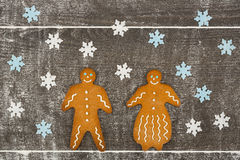 Gingerbread man and lady together on floury table. Stock Photo