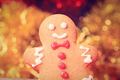 Gingerbread man with lights in background Stock Photo