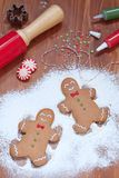 Gingerbread man making a snow angel Royalty Free Stock Photography