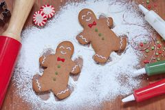 Gingerbread man making a snow angel Royalty Free Stock Images