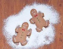 Gingerbread man making a snow angel Stock Photo