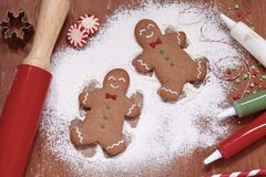 Gingerbread man making a snow angel Royalty Free Stock Photo