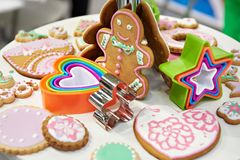 Gingerbread man and molds for baking. On table Stock Photos