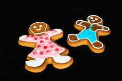 Gingerbread man, mother and son on black velvet Royalty Free Stock Image