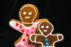 Gingerbread man, mother and son on black velvet Royalty Free Stock Photo