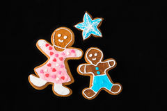 Gingerbread man, mother son and star on black velvet Stock Photography