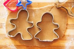 Homemade gingerbread cookies, forms and baking ingredients. Gingerbread man mould. Homemade gingerbread cookies, forms and baking ingredients. Gingerbread man Stock Image