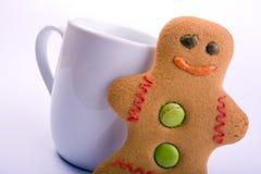 Gingerbread man and mug Royalty Free Stock Photos