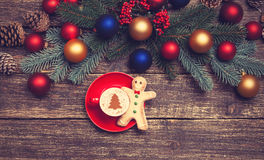 Gingerbread man near Pine branch Stock Photo
