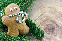 Gingerbread man with pine branches Stock Photo