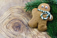 Gingerbread man with pine branches Royalty Free Stock Photography