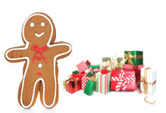Gingerbread Man and Presents Against a White Backg Stock Photo